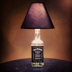 For him. Or her :-) There are so many liquor bottles this would be perfect for a basement/bar, man cave. Half Gallon Jack Daniels Lamp   I made ;)