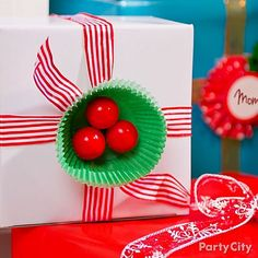 Deck your presents with boughs of gumball holly! Click to see this and more holly jolly Christmas gift wrap ideas.