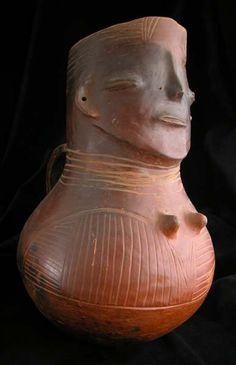 Kuba Terracotta Vessel in the Form of a Woman.    Africa     Origin: Southeastern Congo Circa: 20 th Century AD