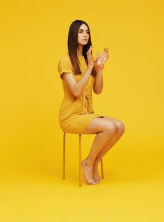 Yellow background in a fashion shoot