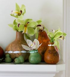 Dried gourds make elegant vases, and together a stunning mantel display. More fall decorating: http://www.bhg.com/decorating/seasonal/fall/easy-fall-decorating-projects/?socsrc=bhgpin101413gourdvases&page=15