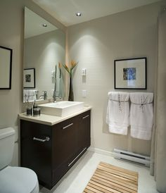 Gorgeous bathroom remodel with a floating vanity, bright white tile floors and a modern flair. Click on the pin to see our best small bathroom design tips!