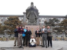 "The CRJU/SOCI group ""suited up"" to visit the Communication University of China."