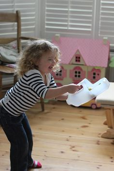 Make an easy catching game from a milk jug in 2 minutes! Great for hand-eye coordination and gross motor skills!