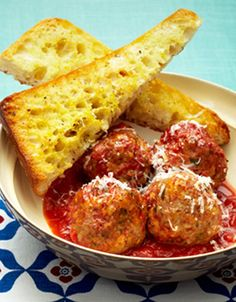 Slow Cooker Italian Meatballs With Garlic Bread.