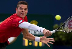 Milos Raonic looks to return a volley during his night match. Rogers Cup 3rd round play between Milos Raonic (CAN) and Julien Benneteau (FRA) on August 7, 2014, at Rexall Centre. Raonic won 6-3, 4-6, 6-4 via Rick Madonik.