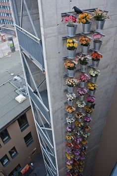 A (literal) Tower of Flowers | Community Post: 39 Insanely Cool Vertical Gardens