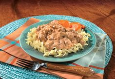 Mexican Stroganoff---Hot cooked egg noodles are topped with a savory mixture of ground beef,onion, taco seasoning mix, Campbell's® Condensed Cream of Mushroom with Roasted Garlic Soup, sour cream and Pace®Picante Sauce.