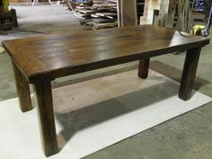 A simple old barn wood table.  I really like the simple design, but I wonder if it needs to be a little thicker.