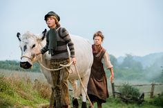 New photo from Disney's remake of Into the Woods!  Daniel Huttlestone as Jack and Tracey Ullman as Jack's mother.  Just saying, but that cow has a spot that is DEFINITELY NOT white as milk...