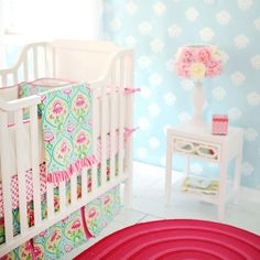 Light Blue polka dot wall with pink accents