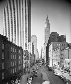 """42nd Street, looking west from 2nd Avenue. Chrysler Building at top right, """"News Tavern"""" """"Goblet Bar"""" at lower right, ca. 1935-1941."""