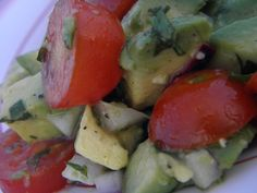Cherry tomato, avocado and red onion salad in a citrus vinaigrette!