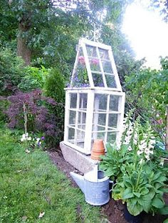 A petite garden conservatory made out of old windows