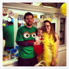 Momma Big Bird, Daddy Grouch, and baby girl Elmo for a Sesame Street 1st Birthday Party