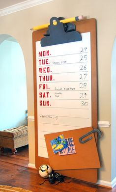 How cute and creative.  A giant clipboard that is a white board and bulletin board!