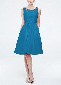 This unique and stylish bridesmaid dress is the epitome of modern chic!  Sleeveless faille dress with beaded neckline.  Cut out back detail.  Pockets add convenience.  Fully lined. Back zip. Imported polyester. Dry clean. To protect your dress, try our Non Woven Garment Bag.