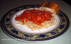 Whole grain linguini and red clam sauce: 3 tbsp olive oil 3 cloves garlic chopped 1 28oz can diced tomatoes 2-3 tbsp tomato paste 2 6.5 oz cans chopped clams