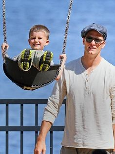 Adorable 3½-year-old Benjamin gets into the swing of things on a Boston playground while doting dad Tom Brady stays close by. http://www.people.com/people/gallery/0,,20705294,00.html#21340739