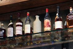Old Fifth boasts a wall of over 140 varieties of whiskey...