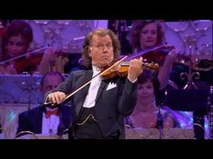 """André Rieu and Johann Strauss Orchestra accompanied by over 500 brass players perform """"Nearer, My God, To Thee"""" live in Amsterdam. A 19th-century Christian hymn by Sarah Flower Adams, based loosely on Genesis 28:11–19, the story of Jacob's dream. """"Nearer, My God, to Thee"""" also associated with the sinking of the Titanic, as some survivors reported that the ship's string ensemble played the hymn as the vessel sank. Think about that moment as you listen to this beautiful music."""
