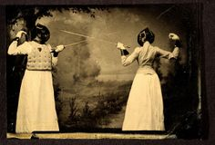 Two women fencing.