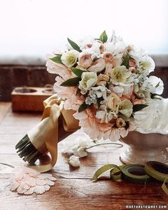 Bouquet of hellebores, allium, sweet peas, and ranunculus (via Martha Stewart Weddings).
