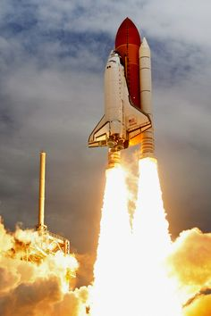 Space shuttle Atlantis blasts off from launch pad 39A at Kennedy Space Center on July 8, 2011. (Chip Somodevilla/Getty Images) #