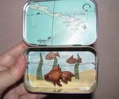 Altoids tin Pocket Fish Tank video tutorial, the fish swims back and forth on a zip line.