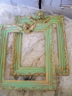 Vintage green ornate frames adorned with cherubs  Anita Spero