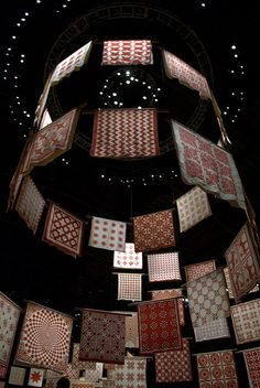 amazing installation of red + white quilts at the American Folk Art Museum
