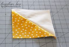 A simple and fast way to sew several triangle-square quilt blocks at once. Big help!