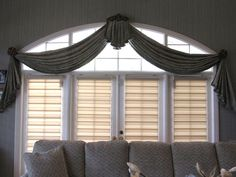 Formal swag draperies with medallions and Illusions Transitional Shades
