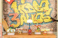 Cool graffiti backdrop at a Superhero Squad themed birthday party Full of Fabulous Ideas via Kara's Party Ideas | Cake, decor, favors, recipes, printables, and MORE! KarasPartyIdeas.com #Superhero #SuperheroSquad #BirthdayParty #PartyIdeas #Backdrop