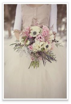 wedding bouquet made of blush pinks, marshmellow whites and aubergine foliage