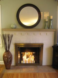 Mantle and candles in fireplace