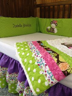 Lime green, purple, pink, brown, and white sock monkey crib set for baby girl