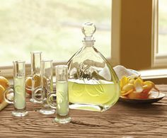 Limoncello Carafe & Glasses. When life hands you lemons, make limoncello.  Available in the Cellar.