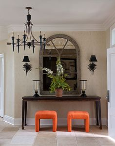 Orange stools from C. Bell are a colorful welcome in the entry.