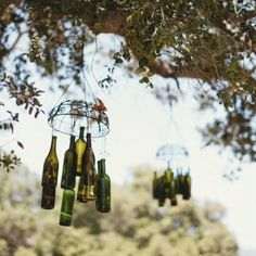Rustic Decor: wine/beer bottles hanging from a wire basket