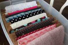 Store fabric on pre-cut cardboard sheets. Place on shelves or in bins or drawers.