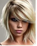 2010 women hairstyle with full of layers with long swept bangs - Copy.PNG