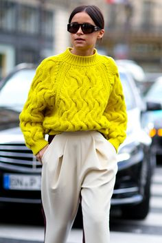 Miroslava Duma in a high-impact sweater. #Streetstyle at Paris Fashion Week #PFW #style #outfit #fashionista #icon #streetstyle #beanie #sunglasses #denim #jakcet #blogger #fashionweek #inspiration #inspo