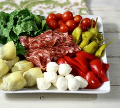 Antipasto Salad #hometailgate - The perfect tailgating finger food tray made with mozzarella balls, artichokes, peppers and Italian Salami, served with a simple balsamic vinaigrette.