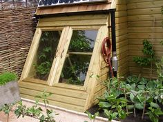 Such a cool cold frame/mini greenhouse I can picture this on my front porch!