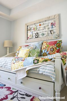 Love this crib spring framed in fabric. ? drop cloth strips. Lots of colorful fabric on pillows, too. From the handmade home summer tour of homes