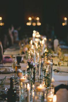 table lined with candles, photo by Shari + Mike Photographers http://ruffledblog.com/black-rock-resort-wedding #weddingreception #tablerunner