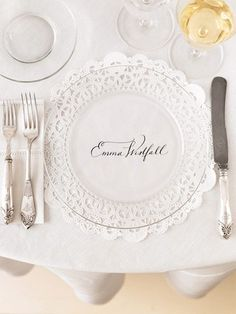 great idea! lace edged doily for name card with clear dinner plate on top
