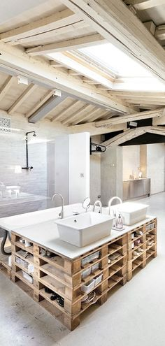 pallet base vanity, blonde wood beams and skylight