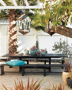 Garden table setting with oversized, worldly light fixtures.